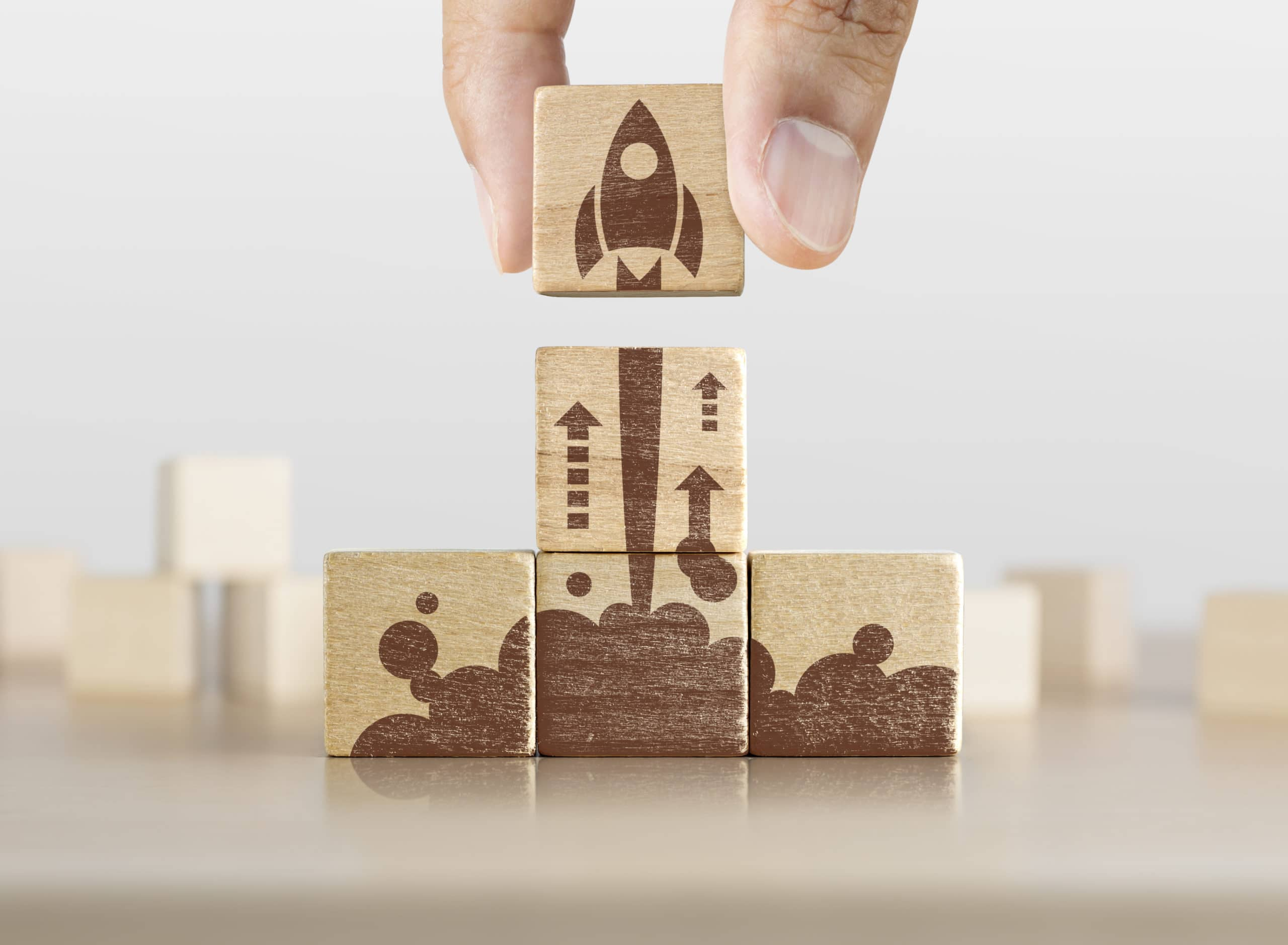 This is an image of building blocks that depict a rocket launching, symbolizing the beginning of a startup.
